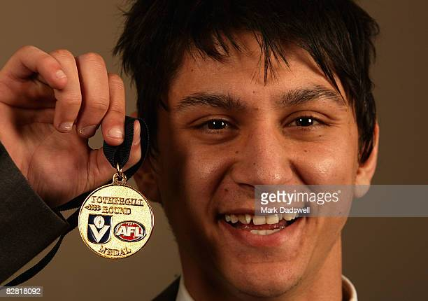 Robin Nahas of the Port Melbourne Football Club holds the FothergillRound Medal for the most promising young player in the competition during the VFL...