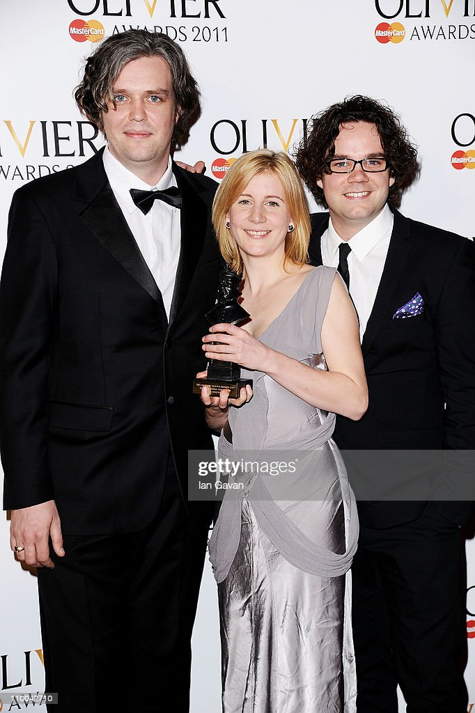 Robin Norton-Hale (C) , winner of Best Opera Production for 'La Boheme' poses in the press room during The Olivier Awards 2011 at Theatre Royal on March 13, 2011 in London, England.