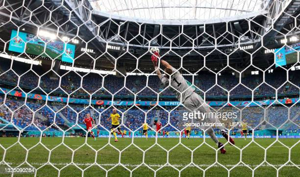Robin Olsen of Sweden fails to save the Poland first goal scored by Robert Lewandowski during the UEFA Euro 2020 Championship Group E match between...