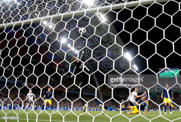 Robin Olsen of Sweden makes a save from Mario Gomez of Germany during the 2018 FIFA World Cup Russia group F match between Germany and Sweden at...