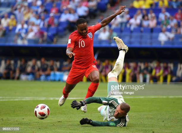 Robin Olsen of Sweden makes a save from Raheem Sterling of England during the 2018 FIFA World Cup Russia Quarter Final match between Sweden and...