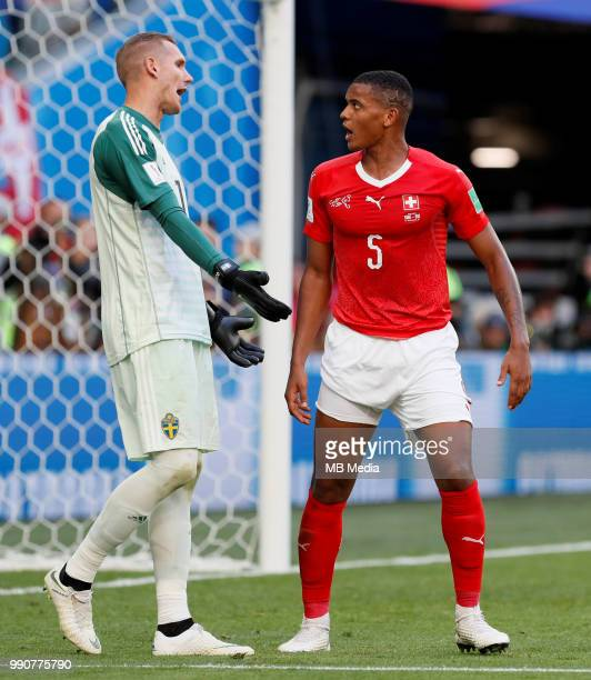 Robin Olsen of Sweden national team and Manuel Akanji of Switzerland national team argue during the 2018 FIFA World Cup Russia Round of 16 match...