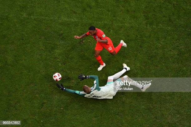 Robin Olsen of Sweden takes the ball from Raheem Sterling of England's feet inside the penalty area during the 2018 FIFA World Cup Russia Quarter...