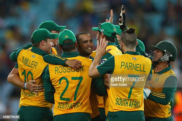 Robin Petersen of South Africa celebrates with his team mates after taking the wicket of Shane Watson of Australia during game three of the Men's...