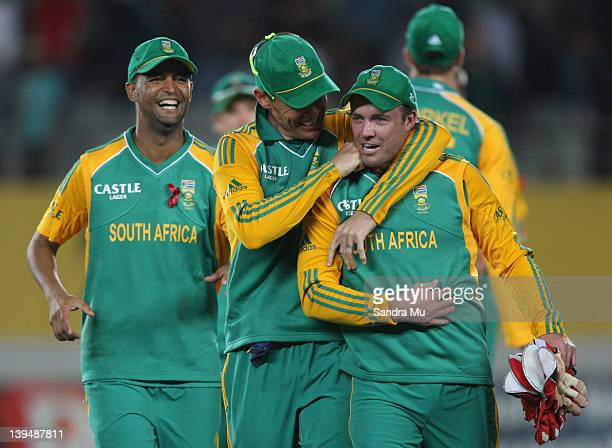 Robin Peterson Johan Botha and Abraham de Villiers of South Africa celebrate their win during the International Twenty20 match between New Zealand...
