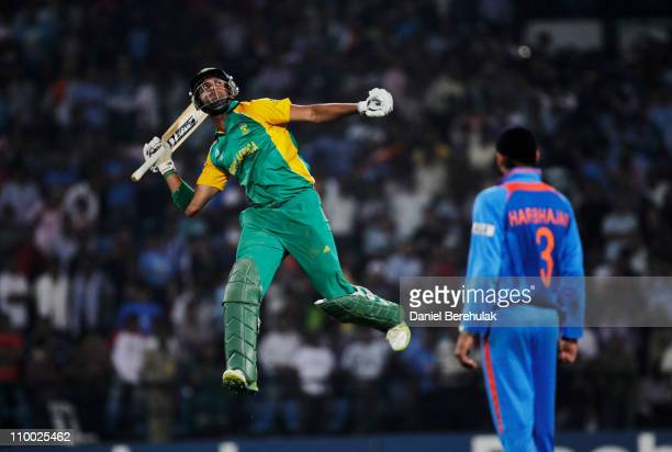 Robin Peterson of South Africa celebrates after scoring the winning runs during the Group B ICC World Cup Cricket match between India and South...