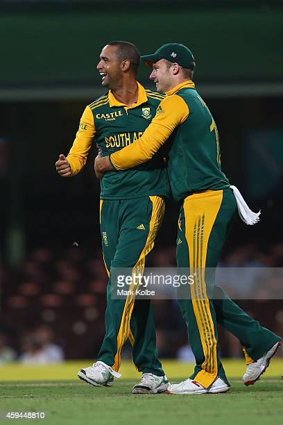 Robin Peterson of South Africa celebrates with David Miller of South Africa after taking the wicket of Matthew Wade of Australia during game five of...