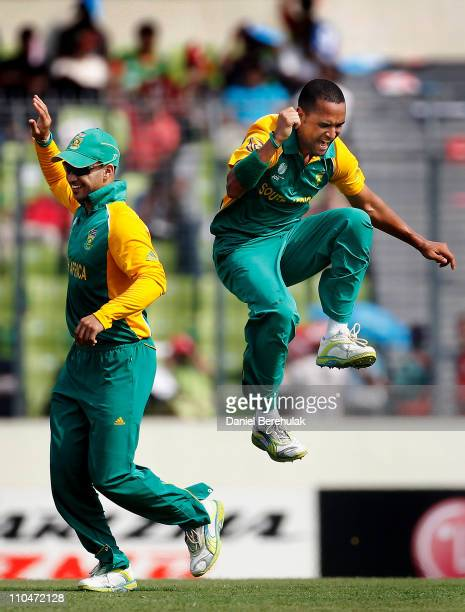 Robin Peterson of South Africa celebrates with team mate JP Duminy after taking the wicket of Mushfiqur Rahim of Bangladesh caught by Graeme Smith...