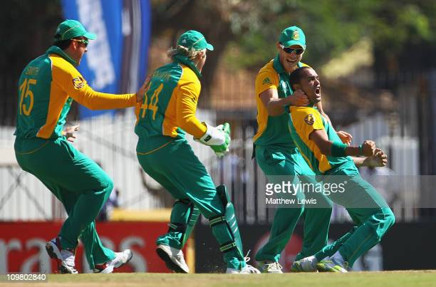 Robin Peterson of South Africa is congratulated by team mates after Kevin Pietersen of England was caught by Jacques Kallis during the 2011 ICC World...