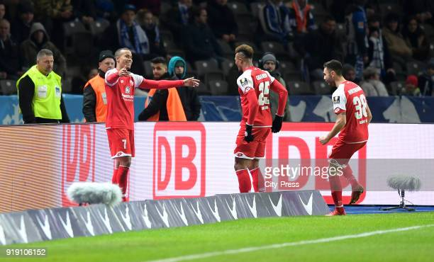 Robin Quaison, Jean-Philippe Gbamin and Gerrit Holtmann of FSV Mainz 05 celebrate after scoring the 0:2 during the first Bundesliga game between...