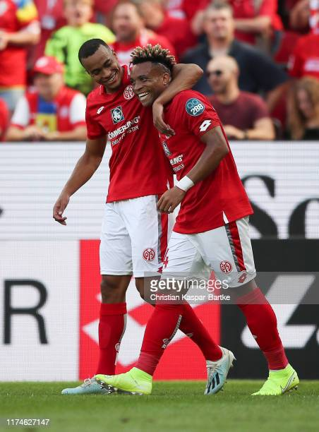 Robin Quaison of 1. FSV Mainz 05 celebrates after scoring his team's first goal with Pierre Kunde Malong during the Bundesliga match between 1. FSV...