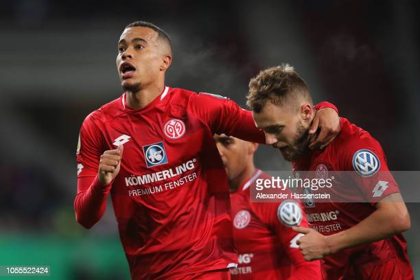 Robin Quaison of FSV Mainz celebrates scoring his teams second goal of the game with team mate Alexandru Maxim during the DFB Cup match between FC...