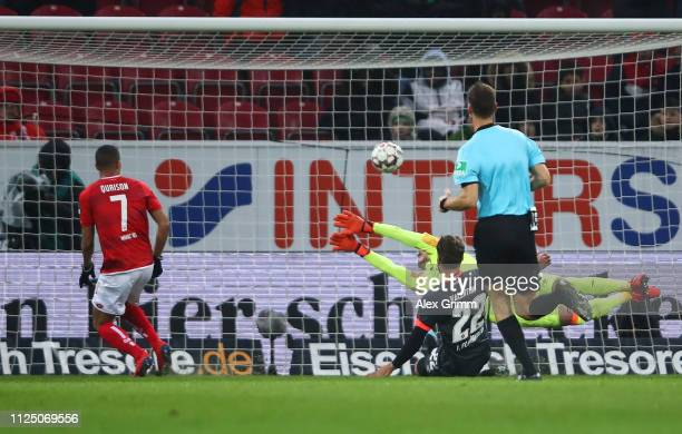 Robin Quaison of FSV Mainz scores his team's second goal past Christian Mathenia of Nuernberg during the Bundesliga match between 1. FSV Mainz 05 and...