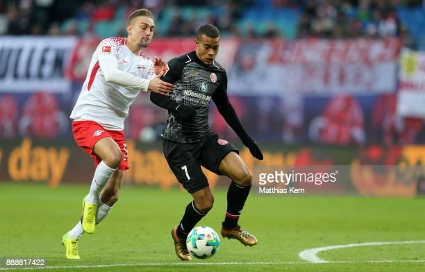 Robin Quaison of Mainz battles for the ball with Stefan Ilsanker of Leipzig during the Bundesliga match between RB Leipzig and 1FSV Mainz 05 at Red...