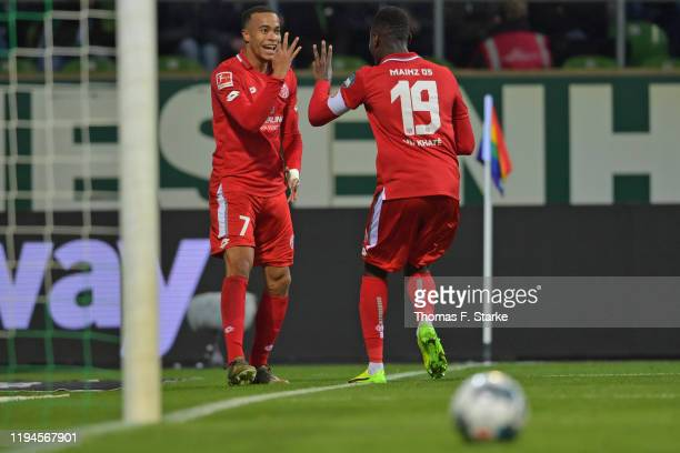 Robin Quaison of Mainz celebrates his third goal with Moussa Niakhate of Mainz during the Bundesliga match between SV Werder Bremen and 1. FSV Mainz...