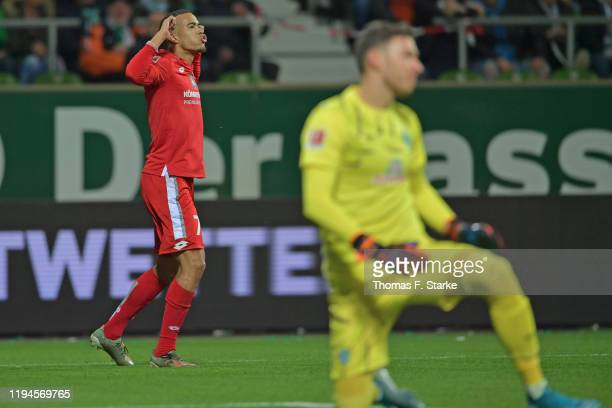 Robin Quaison of Mainz celebrates scoring his teams first goal against goalkeeper Jiri Pavlenka during the Bundesliga match between SV Werder Bremen...