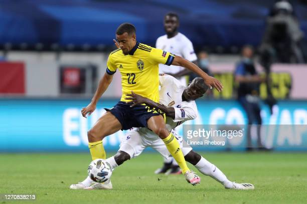 Robin Quaison of Sweden is challenged by N'Golo Kante of France during the UEFA Nations League group stage match between Sweden and France at Friends...