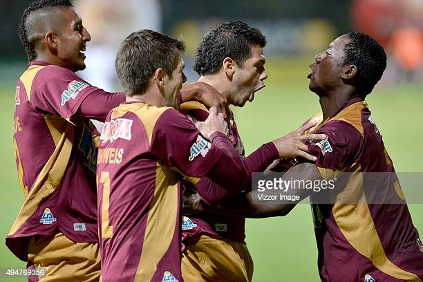 Robin Ramirez of Deportes Tolima celebrates with his teammates after scoring the third goal of his team during the match between Deportes Tolima and...