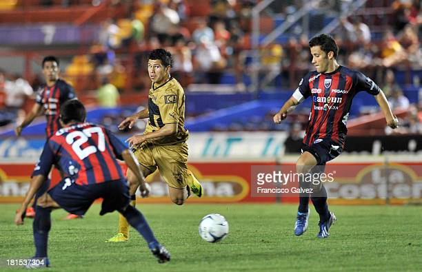 Robin Ramirez of Pumas and Jose Guerrero of Atlante fights for the ball during a match between Atlante and Pumas UNAM as part of the Apertura 2013...