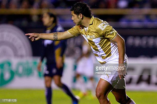 Robin Ramirez of Pumas celebrates during a match between San Luis and Pumas as part of the Apertura 2013 Copa MX at Alfonso Lastras Stadium on August...