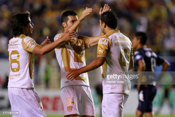 Robin Ramirez of Pumas celebrates with his teammates during a match between San Luis and Pumas as part of the Apertura 2013 Copa MX at Alfonso...