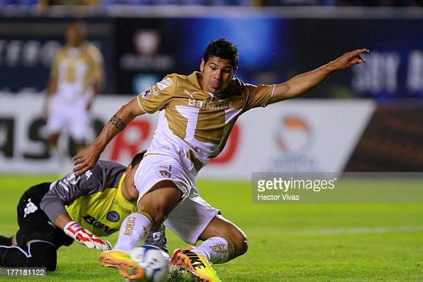 Robin Ramirez of Pumas fights for the ball with Alfonso Blanco of San Luis during a match between San Luis and Pumas as part of the Apertura 2013...