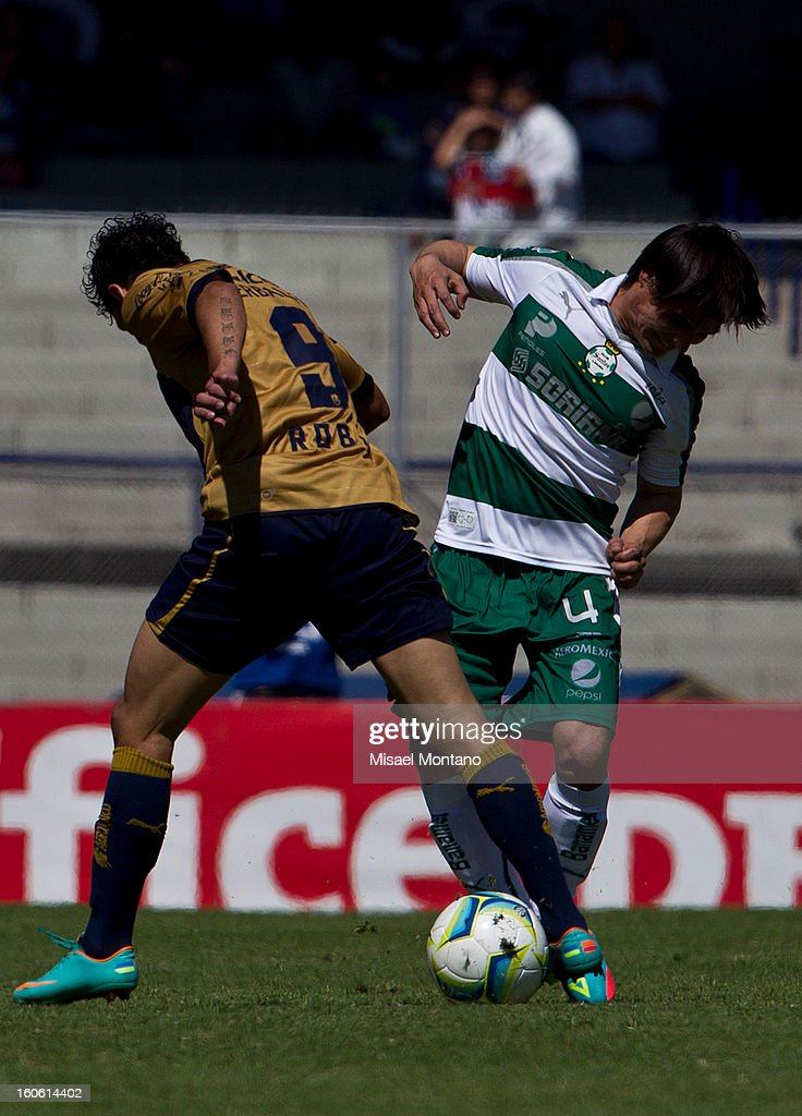 Robin Ramirez of Pumas fights for the ball with Ivan Estrada of Santos during a match between Pumas and Santos as part of the Clausura 2013 at Olímpico Stadium on February 03, 2013 in Mexico City, Mexico.
