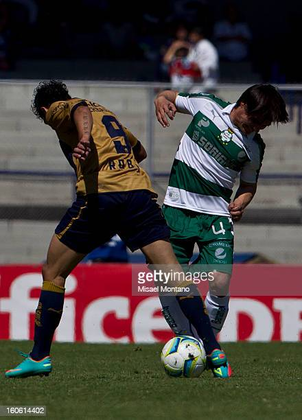 Robin Ramirez of Pumas fights for the ball with Ivan Estrada of Santos during a match between Pumas and Santos as part of the Clausura 2013 at...