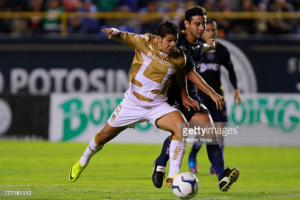 Robin Ramirez of Pumas fights for the ball with Omar Dominguez of San Luis during a match between San Luis and Pumas as part of the Apertura 2013...