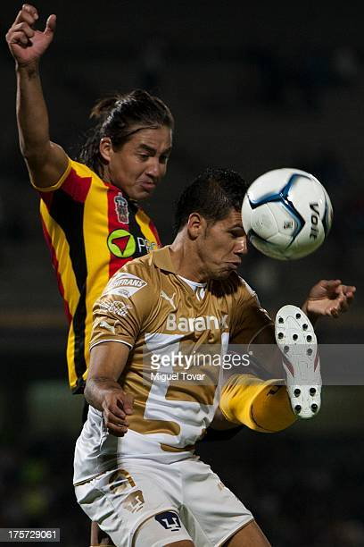 Robin Ramirez of Pumas struggles for the ball with Christian Lopez of Leones Negros during a match between Pumas and Leones Negros as part of the...
