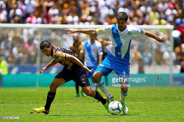 Robin Ramirez of Pumas struggles for the ball with Jonathan Lacerda of Puebla during a match between Pumas and Puebla as part of the Torneo Apertura...