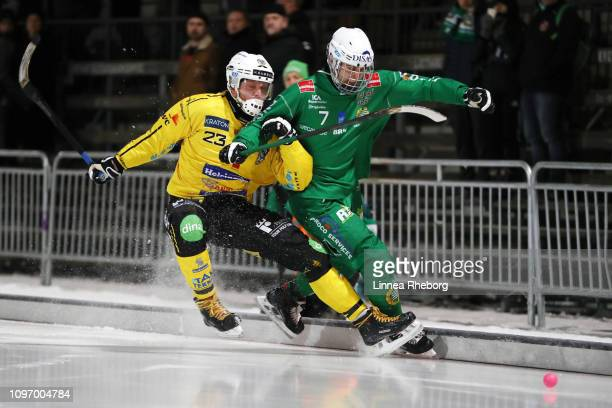 Robin Redin of Broberg/Soderhamn Bandy clashes with Jesper Jonsson of Hammarby Bandy during the Elitserien bandy match between Hammarby Bandy and...