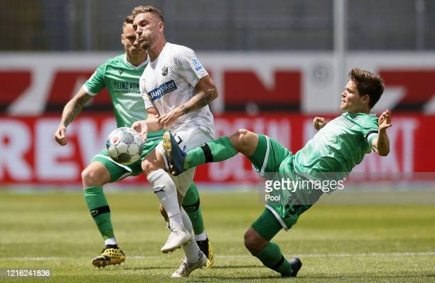 Robin Scheu of Sandhausen in action against Dominik Kaiser of Hannover during the Second Bundesliga match between SV Sandhausen and Hannover 96 at...