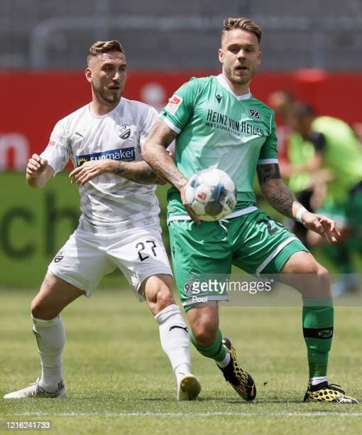 Robin Scheu of Sandhausen in action against Marcel Franke of Hannover during the Second Bundesliga match between SV Sandhausen and Hannover 96 at...