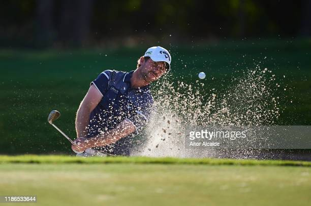 Robin SciotSiegrist of France chips out of the bunker onto the 17th green during day 3 of the Challenge Tour Grand Final at Club de Golf Alcanada on...
