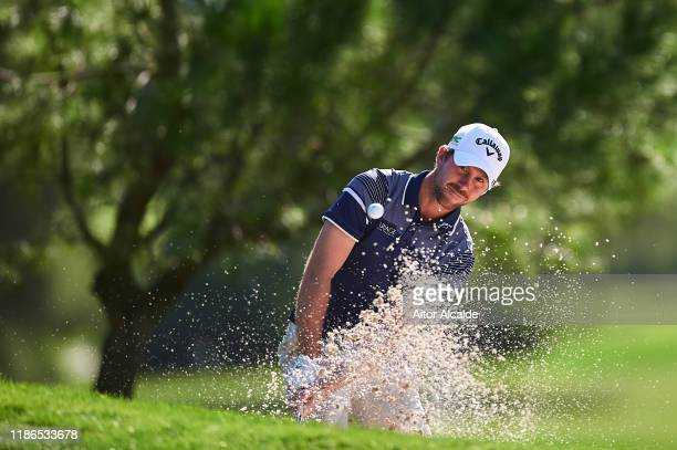 Robin SciotSiegrist of France chips out of the bunker onto the 6th green during day 3 of the Challenge Tour Grand Final at Club de Golf Alcanada on...