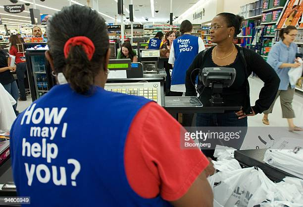 Robin Shear, right, of Manassas, Virginia, waits for her purchases to be rung up at the check-out line of a Wal-Mart store in Woodbridge, Virginia on...
