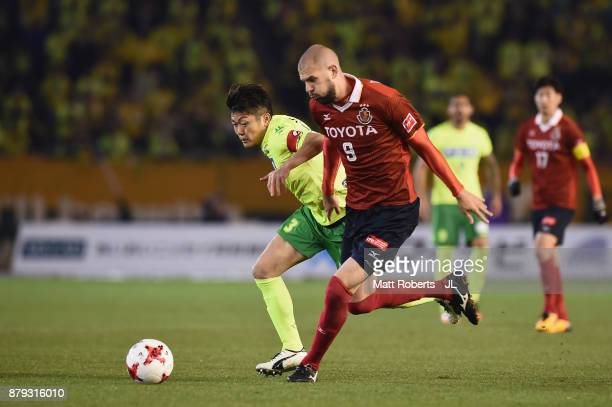 Robin Simovic of Nagoya Grampus and Naoya Kondo of JEF United Chiba compete for the ball during the JLeague J1 Promotion PlayOff semi final match...