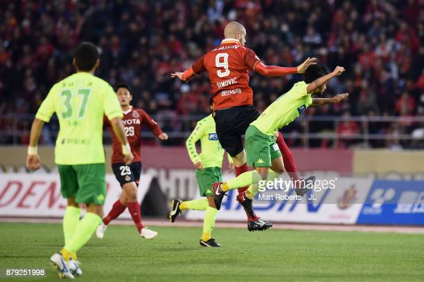 Robin Simovic of Nagoya Grampus and Yuto Sato of JEF United Chiba compete for the ball during the JLeague J1 Promotion PlayOff semi final match...