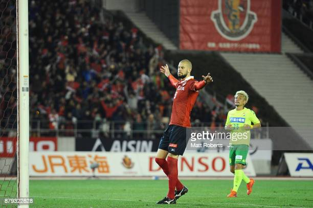 Robin Simovic of Nagoya Grampus celebrates scoring his side's fourth and his hat trick goal from the penalty spot during the JLeague J1 Promotion...