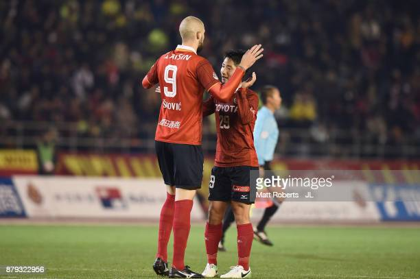 Robin Simovic of Nagoya Grampus celebrates scoring his side's fourth and his hat trick goal with his team mate Ryuji Izumi during the JLeague J1...