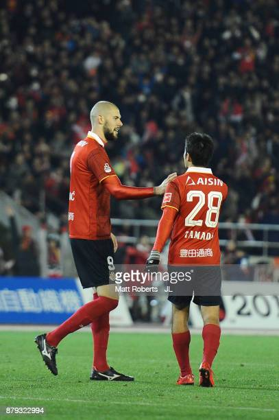 Robin Simovic of Nagoya Grampus celebrates scoring his side's fourth and his hat trick goal with his team mate Keiji Tamada during the JLeague J1...