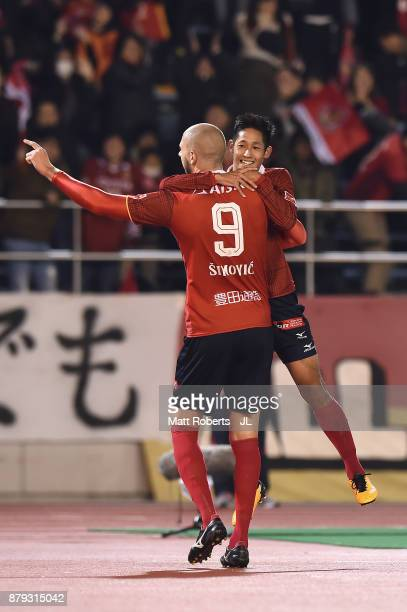 Robin Simovic of Nagoya Grampus celebrates scoring his side's third goal with his team mate Ryota Aoki during the JLeague J1 Promotion PlayOff semi...