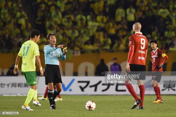 Robin Simovic of Nagoya Grampus is shown a yellow card by referee Nobutsugu Murakami during the JLeague J1 Promotion PlayOff semi final match between...
