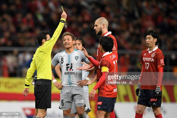 Robin Simovic of Nagoya Grampus is shown a yellow card by referee Hiroyuki Kimura during the JLeague J1 Promotion PlayOff Final between Nagoya...