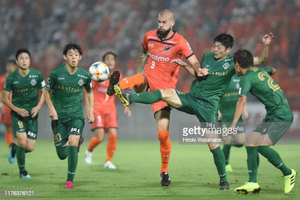 Robin Simovic of Omiya Ardija and Naoya Kondo of Tokyo Verdy compete for the ball during the J.League J2 match between Omiya Ardija and Tokyo Verdy...
