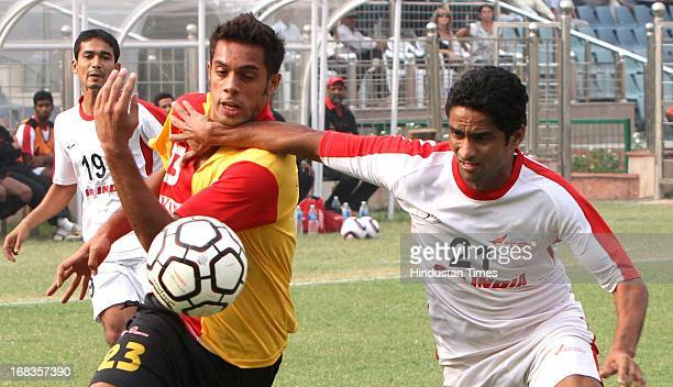 Robin Singh of East Bengal Club and Amrit Pal Singh of Air India vie for ball during the 123rd Edition of Durand Football Tournament at Ambedkar...