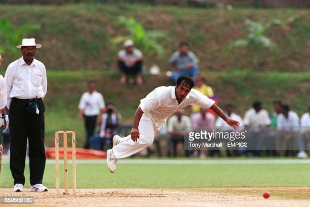 Robin Singh of India bowling against Australia