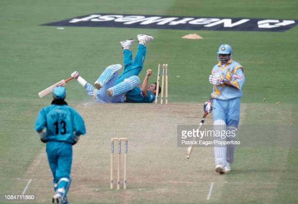 Robin Singh of India is run out by Chris Cairns of New Zealand during the World Cup Super Six match between India and New Zealand at Trent Bridge...