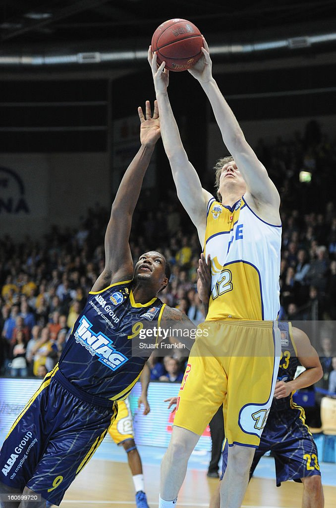 Robin Smeulders of Oldenburg challenges for the ball with Deon Thompson of Berlin during the BBL game between EWE Baskets Oldenburg and Alba Berlin at the EWE arena on February 3, 2013 in Oldenburg in Holstein, Germany.